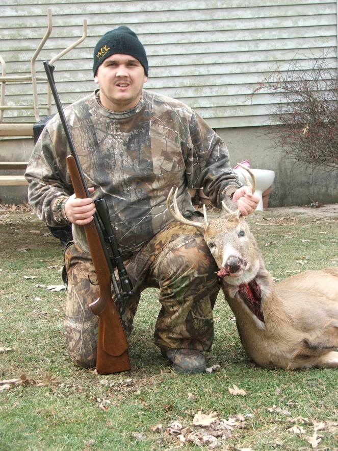 Josh and his 8 pt buck